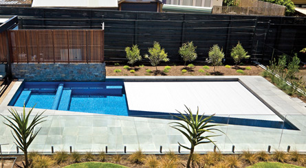 Automatic pool covers for odd shaped pools Trapezoid Shaped Swimroll Is Customized To Fit Variety Of Pool Shapes Remco Pool Covers And Enclosures Automatic Pool Covers Hidden Integrated Pool Cover In Melbourne